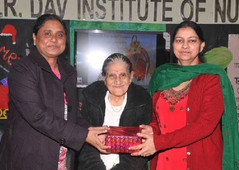 X-Mas Gift gifted by Honorable Chief Guest Mrs. Zeenat Williams and Respected Principal Madam Mrs. Veena Williams to  Vice Principal Madam Dr.(Mrs.) Harbans Kaur