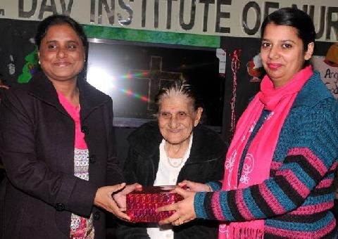 X-Mas Gift gifted by Honorable Chief Guest Mrs. Zeenat Williams and Respected Principal Madam Mrs. Veena Williams to  Lecturer Mrs. Baljinder Kaur